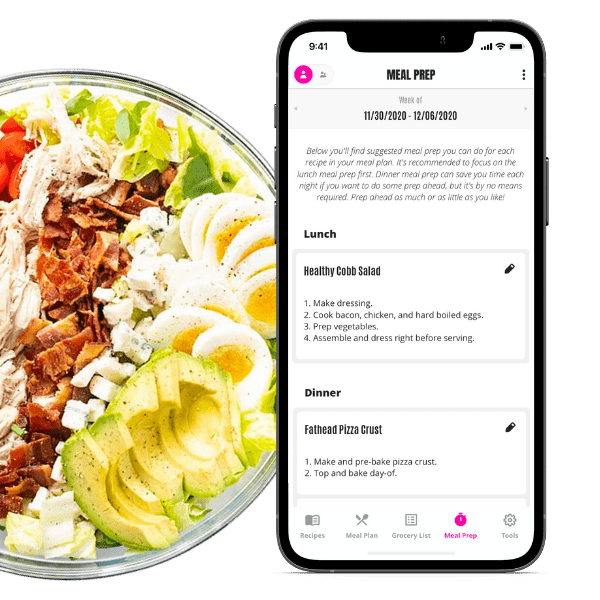 Easy Keto Meal Plans App open to meal prep tips, next to a bowl of keto cobb salad