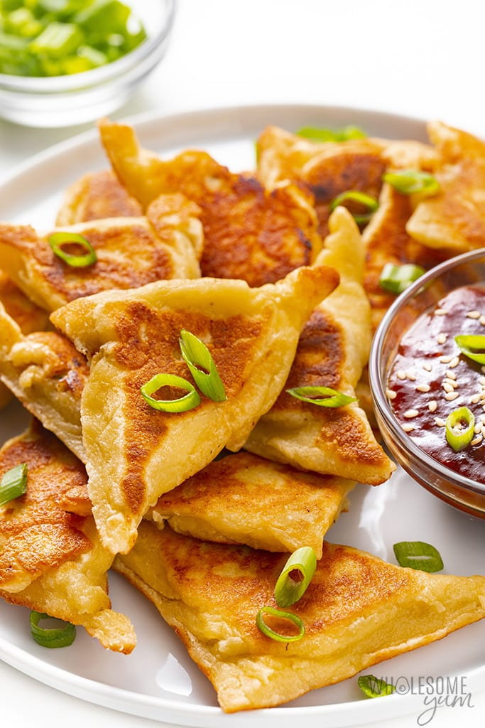 Plate of low carb crab rangoon with sweet and sour sauce