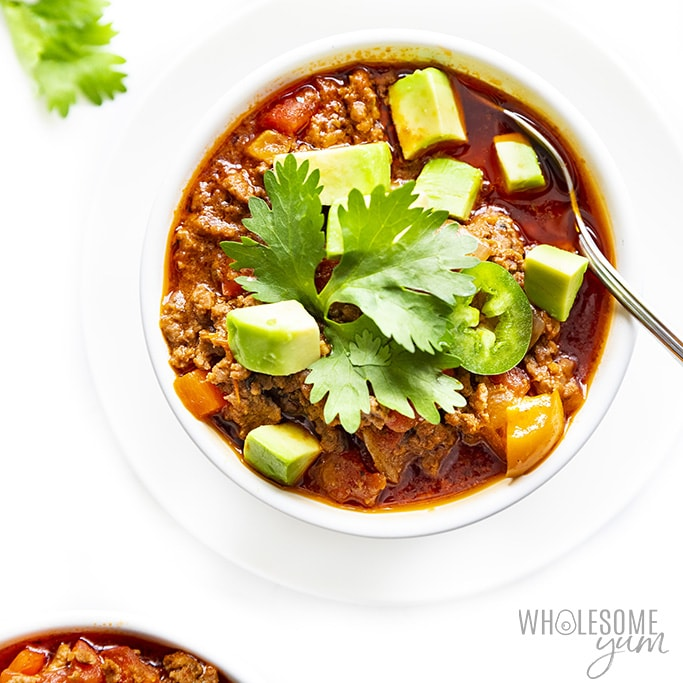 Are Bell Peppers Keto? - Whole30 chili in a white bowl topped with avocado and jalapenos