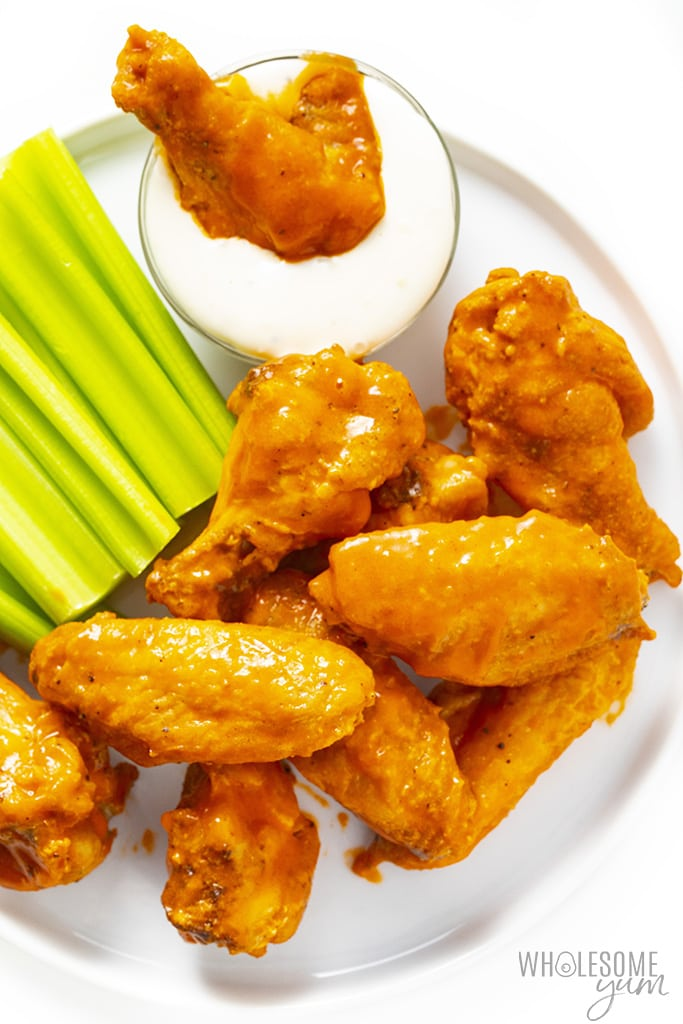 Buffalo chicken wings on a plate with celery