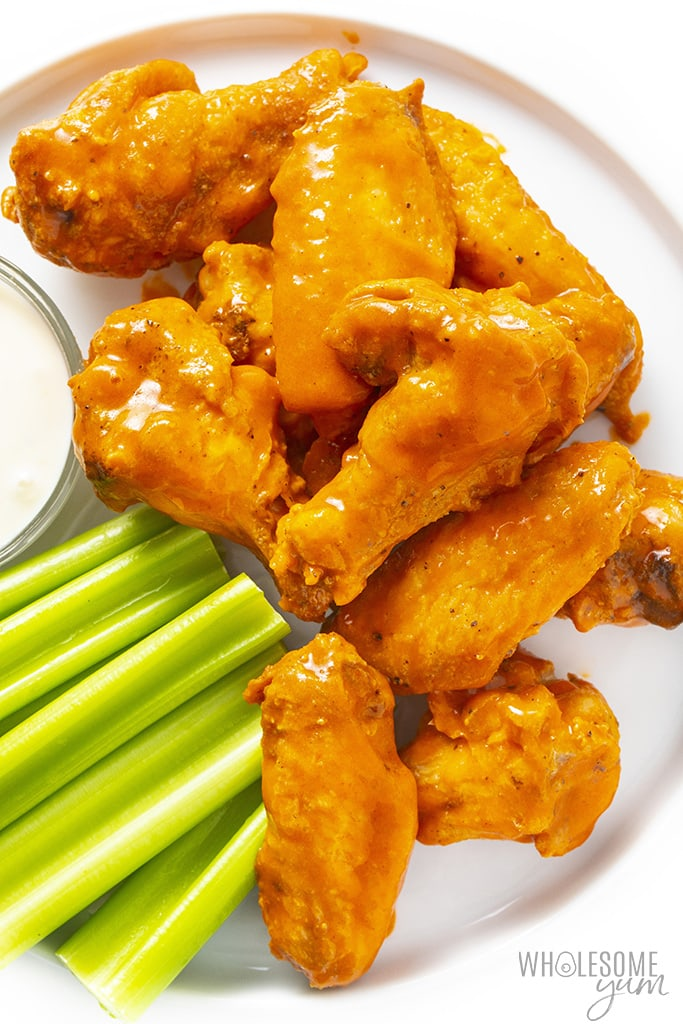 Baked buffalo wings on a plate with celery