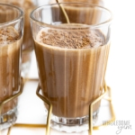 Glasses of keto chocolate milk in a holder