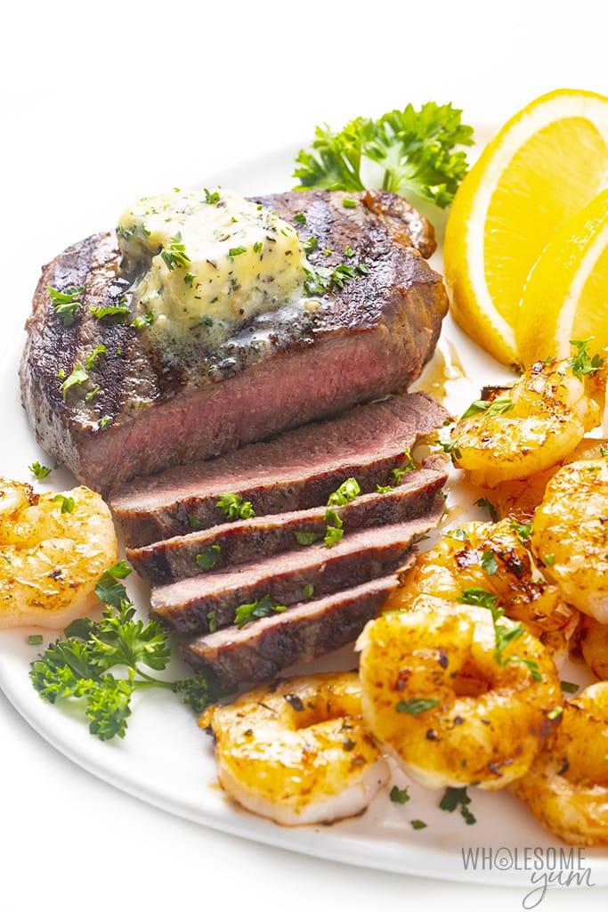 Sliced steak on a plate with shrimp