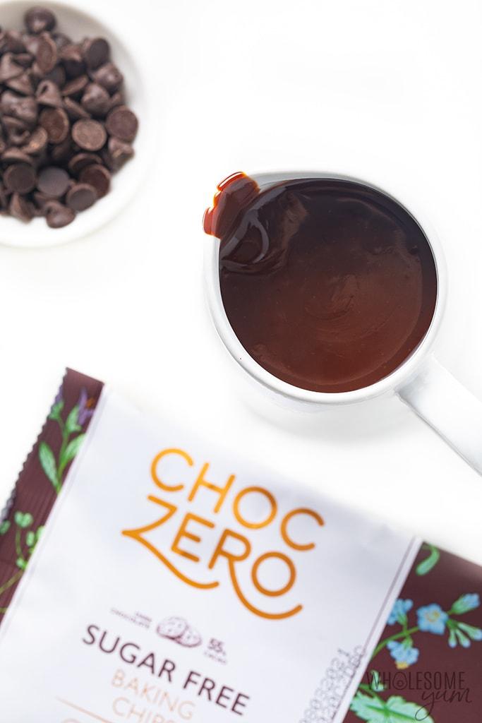 White jar of keto chocolate syrup with ChocZero chocolate chips