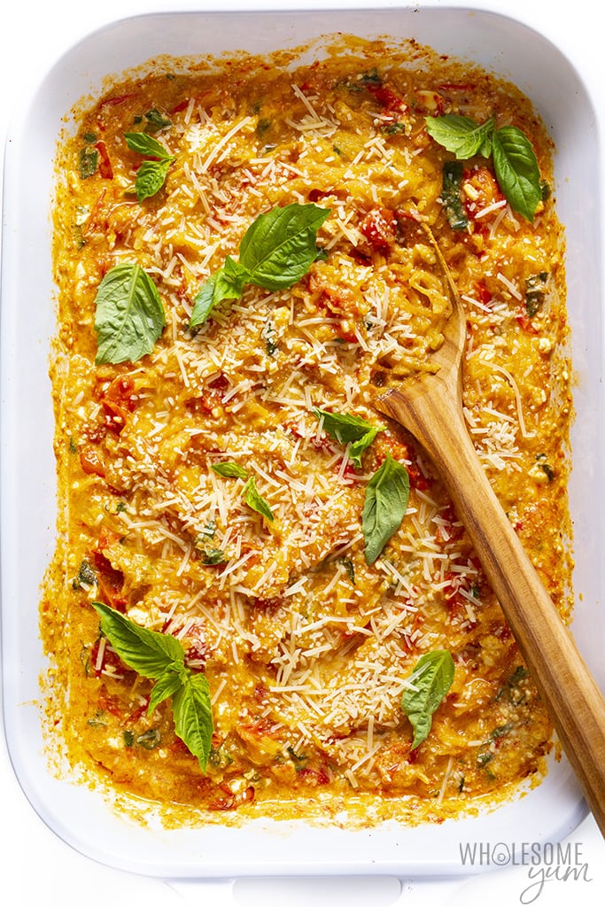 Keto feta pasta in a baking dish with fresh basil