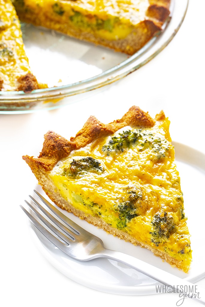 Slice of broccoli cheese quiche on plate