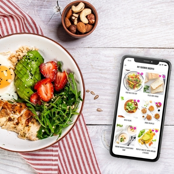 Favorites view on Easy Keto App next to plate of keto foods