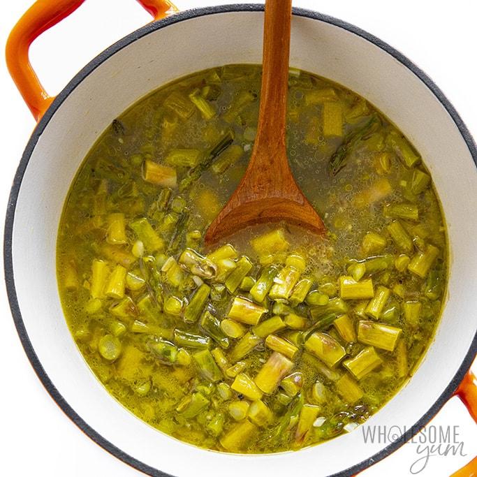 Sauteed asparagus with broth for asparagus soup