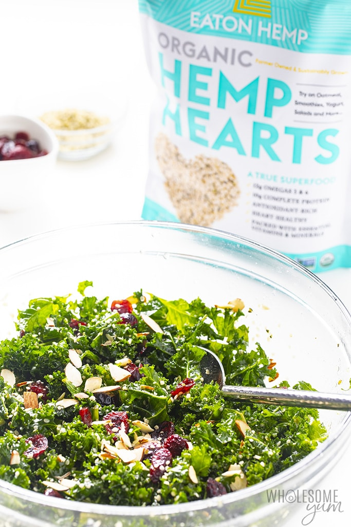 Bowl of kale crunch salad with hemp hearts in the background