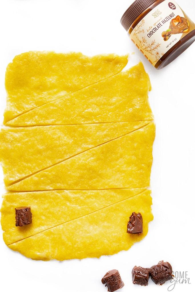 Dough for keto butter croissants cut into pieces