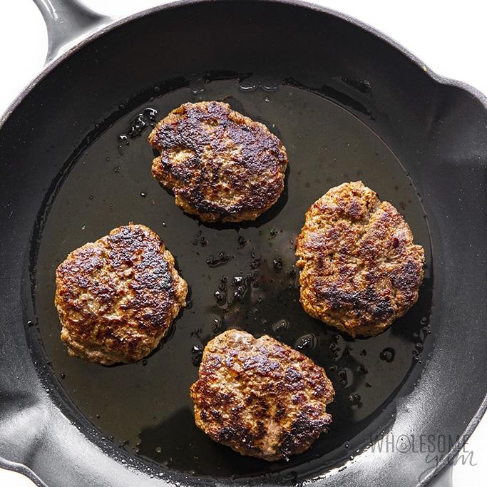 Keto salisbury steaks cooking in pan