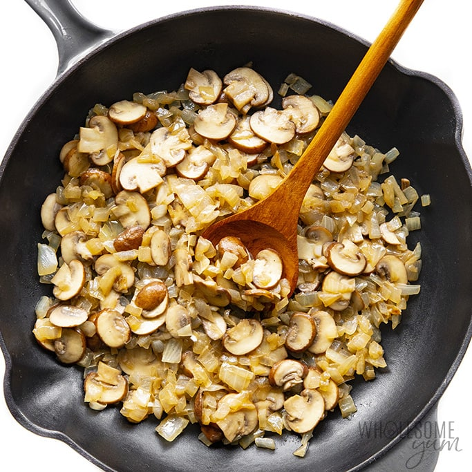 Sauteed mushrooms and onions in a skillet
