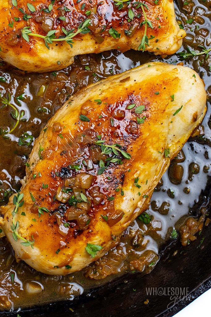 Stovetop chicken breast close up in a skillet