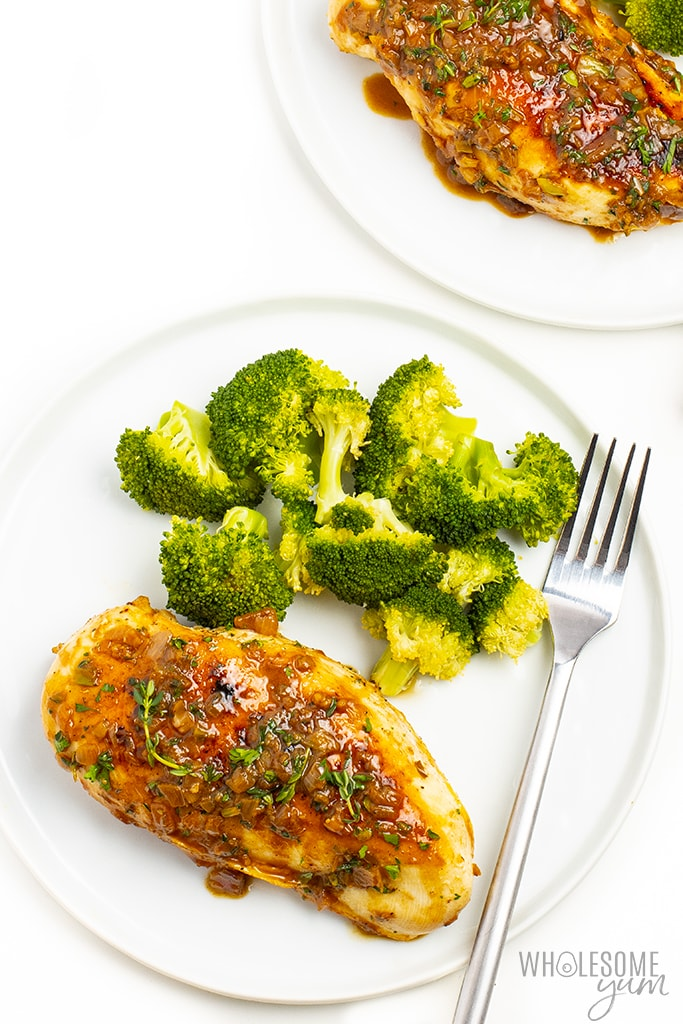 Pan seared chicken breast on 2 plates with broccoli