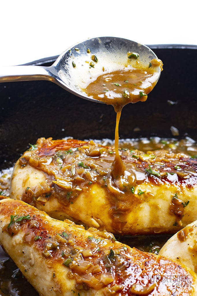 Pan seared chicken breast with pan sauce drizzled over it