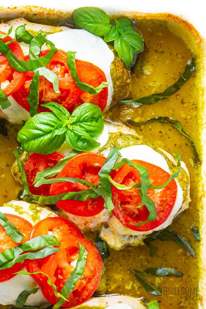 Mozzarella pesto chicken breasts in a baking dish