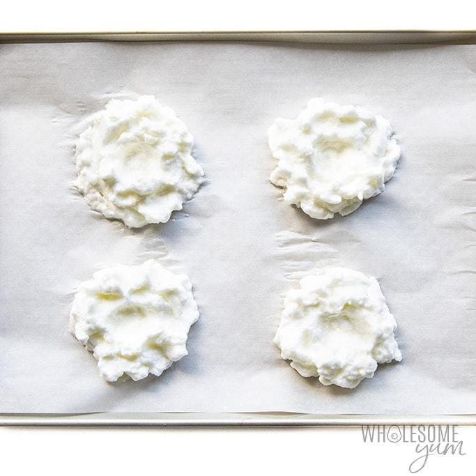 Whipped egg whites on a baking sheet