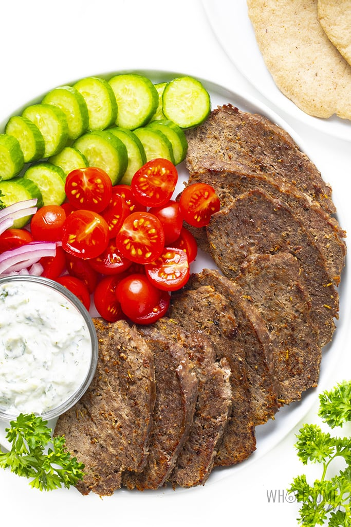 Gyro meat with toppings on a platter