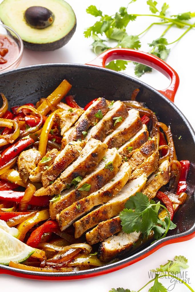 Chicken fajitas in a red skillet