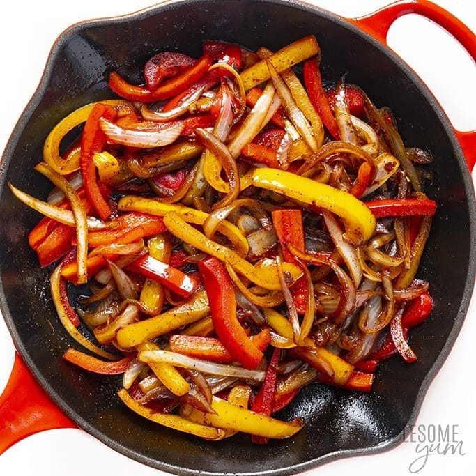 Skillet with sauteed peppers and onions for fajitas