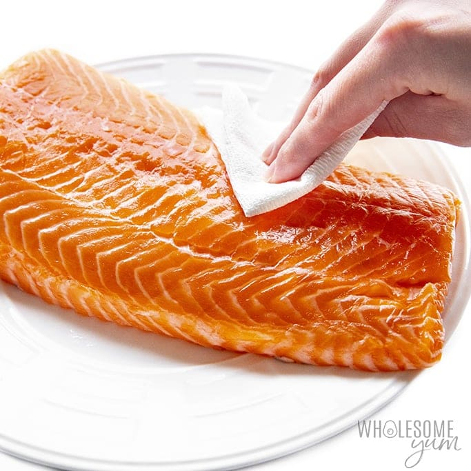 Patting dry salmon for homemade lox