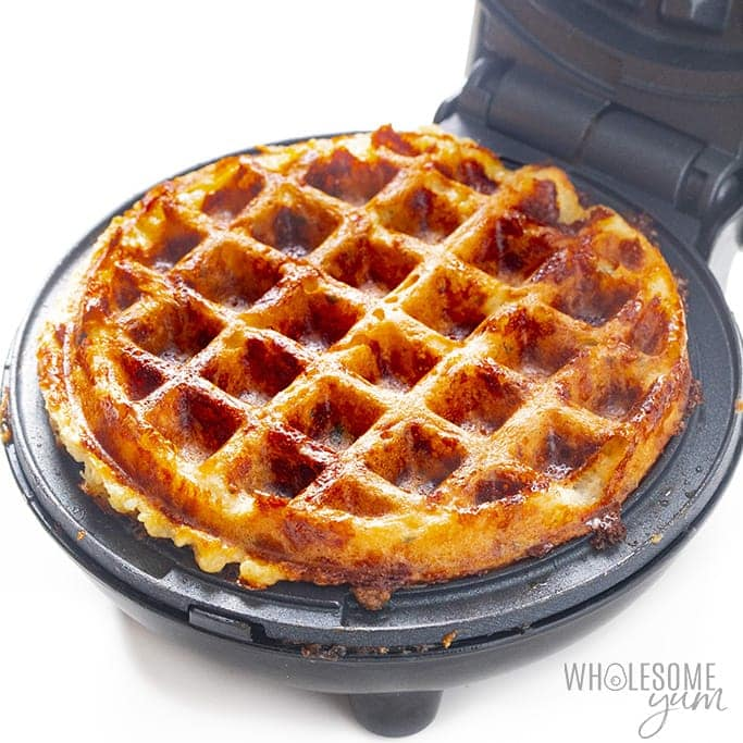 Cooked chaffle pizza base in waffle maker