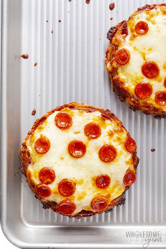 Fully cooked keto chaffle pizzas on a baking pan
