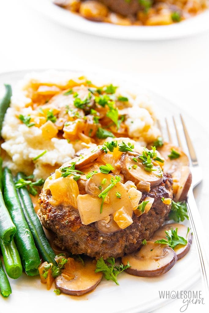 2 plates of low carb salisbury steak with cauliflower mash and green beans