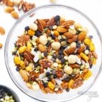 Bowl of keto trail mix in a glass bowl