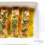 Baking dish with salmon marinade on salmon fillets