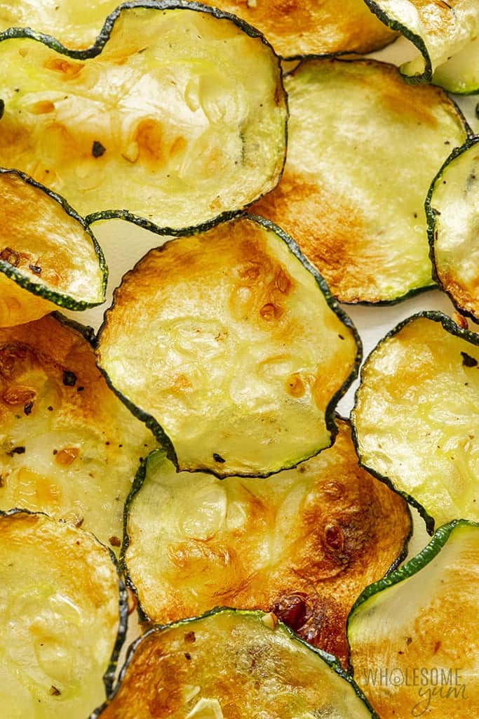 Air fried zucchini chips scattered