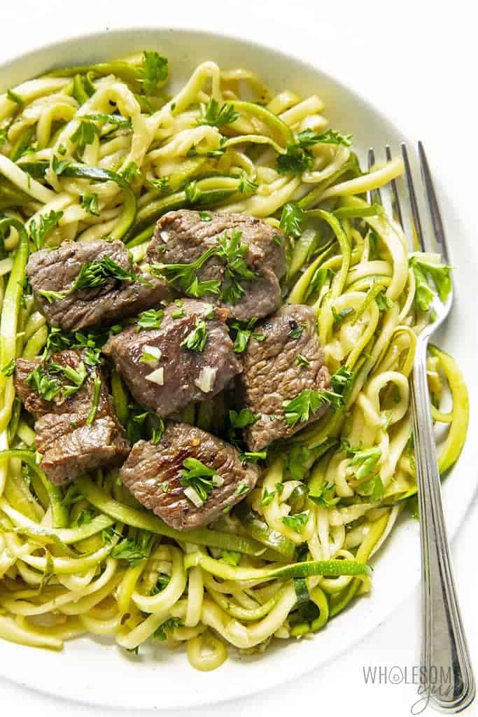 Garlic butter steak bites with zoodles on a plate