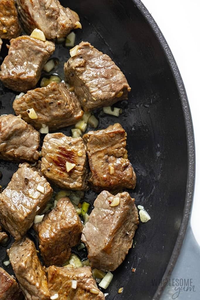 Steak bites with garlic butter in a cast iron skillet