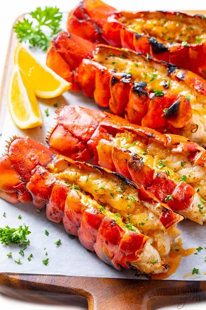 The perfect grilled lobster tail recipe with lemon wedges and parsley