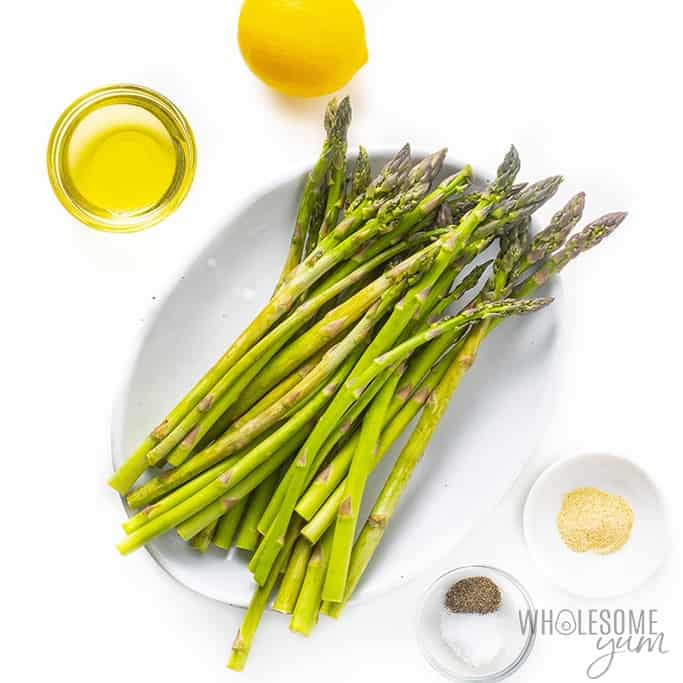 Grilled asparagus ingredients on plates and in bowls