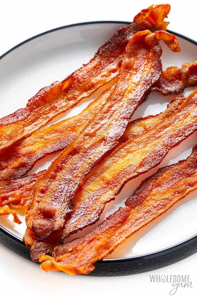 Microwave bacon on a plate from side view