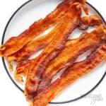 Crispy microwave bacon slices on a plate