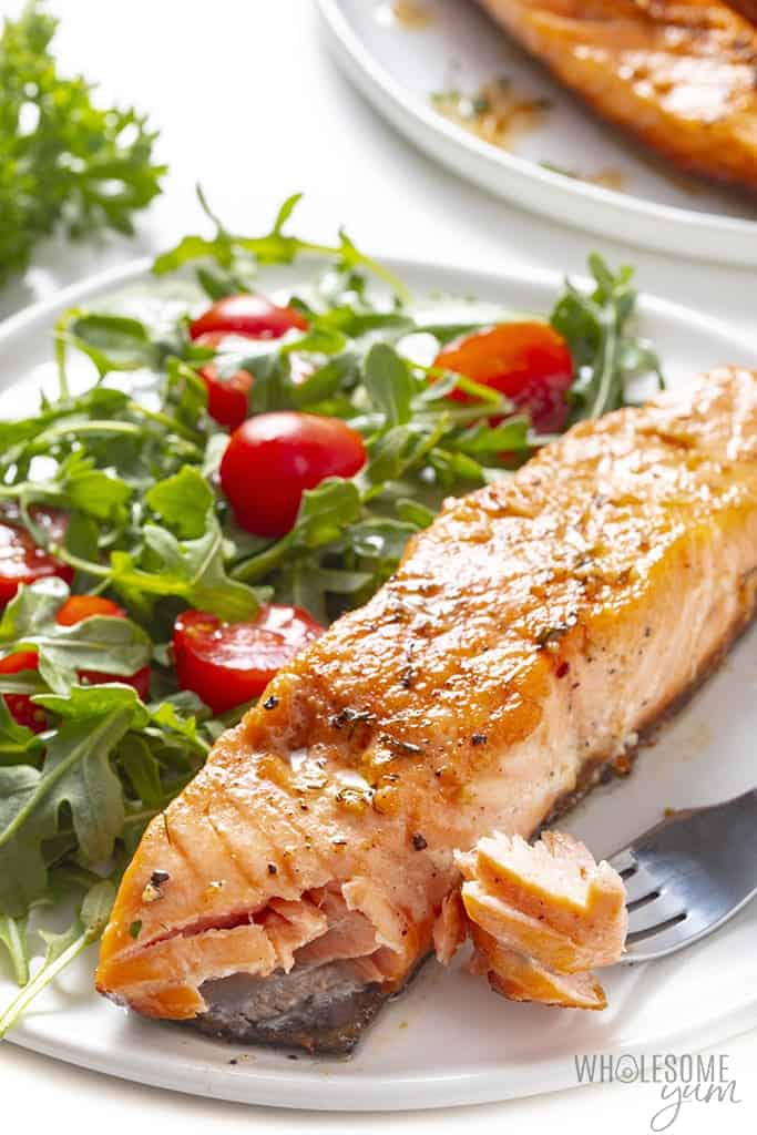 Piece of pan fried salmon on a plate