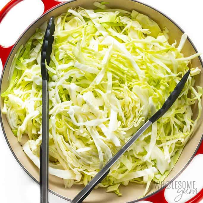 Raw cabbage added to the pan