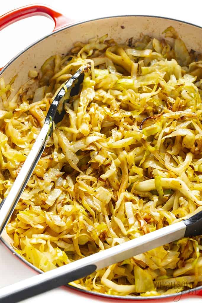 Showing how to saute cabbage in a large pan