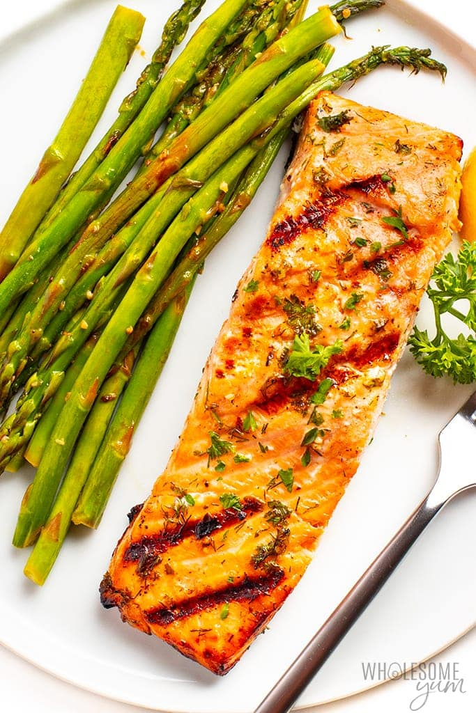 Easy grilled salmon on a plate with asparagus