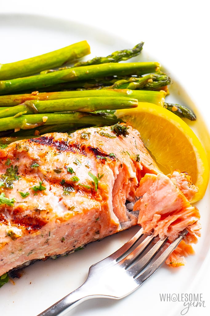 Grilled salmon recipe being flaked with a fork