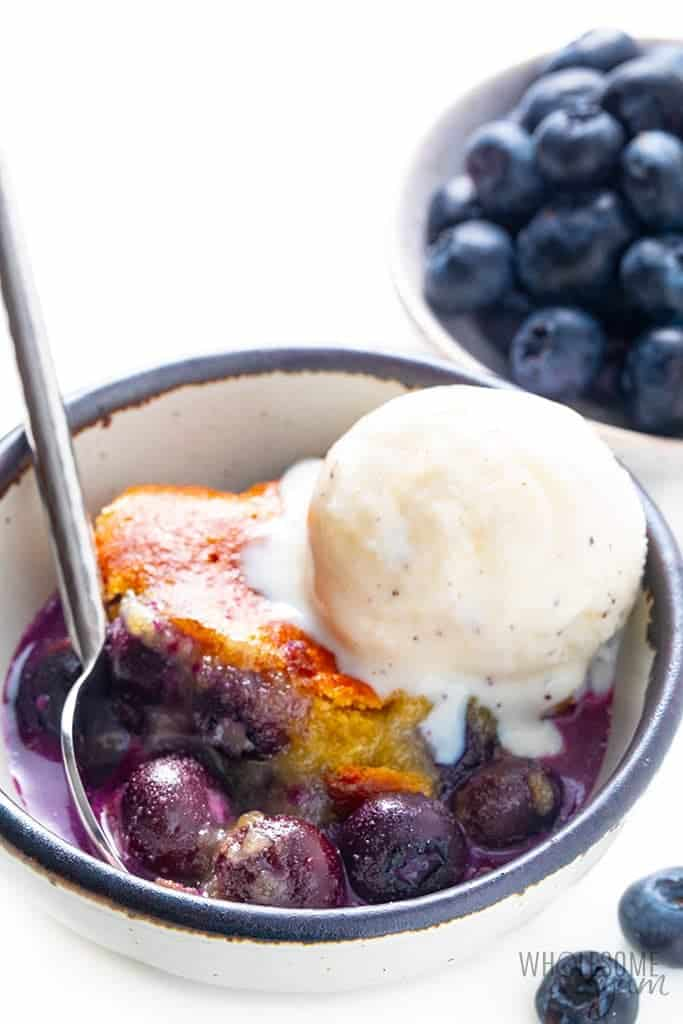 Low carb cobbler with blueberries in background