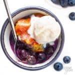 Keto blueberry cobbler recipe in a bowl with ice cream
