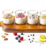 Flavors of keto overnight oats in jars on a wooden cutting board
