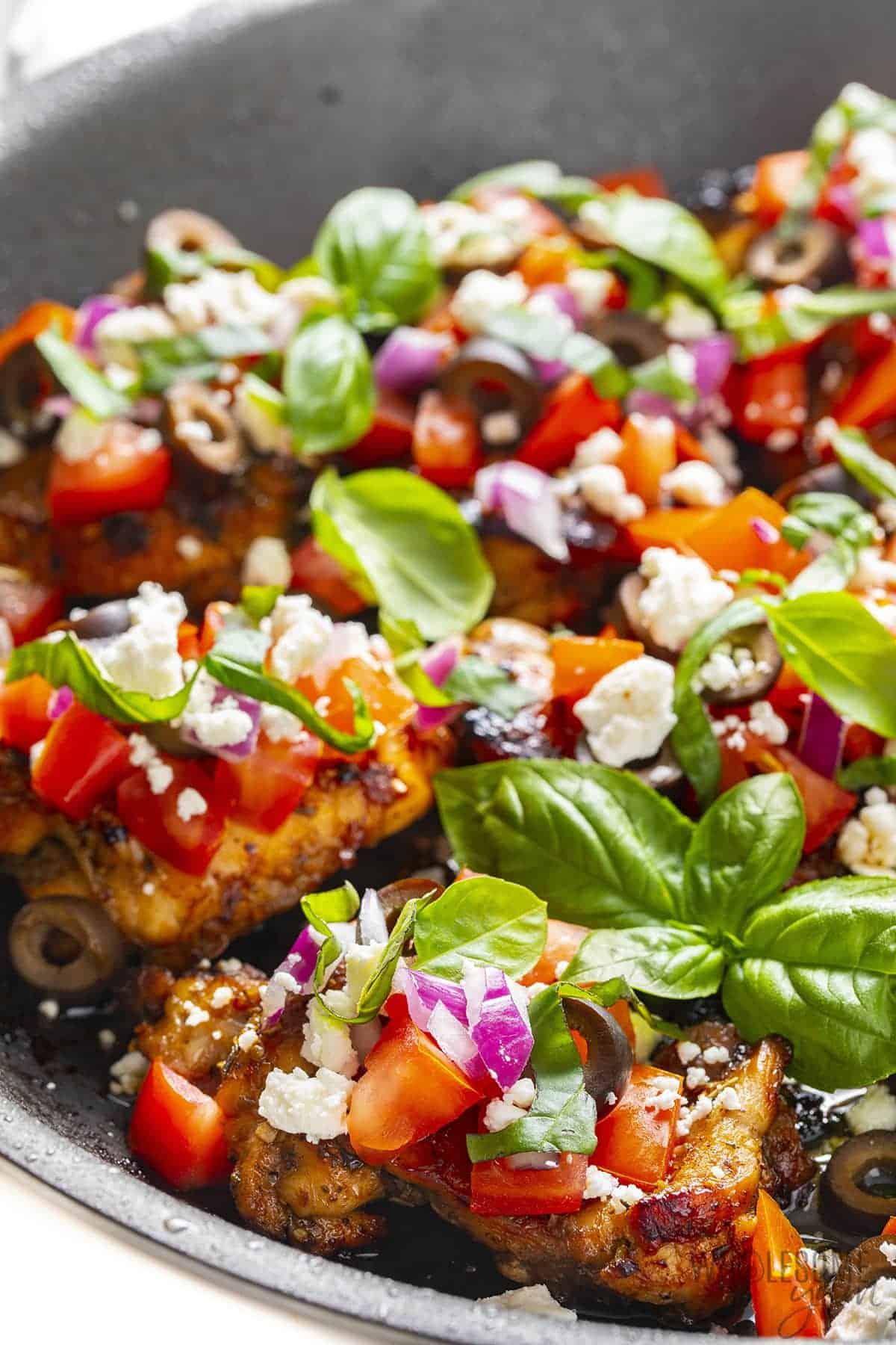 Mediterranean chicken thighs in a skillet
