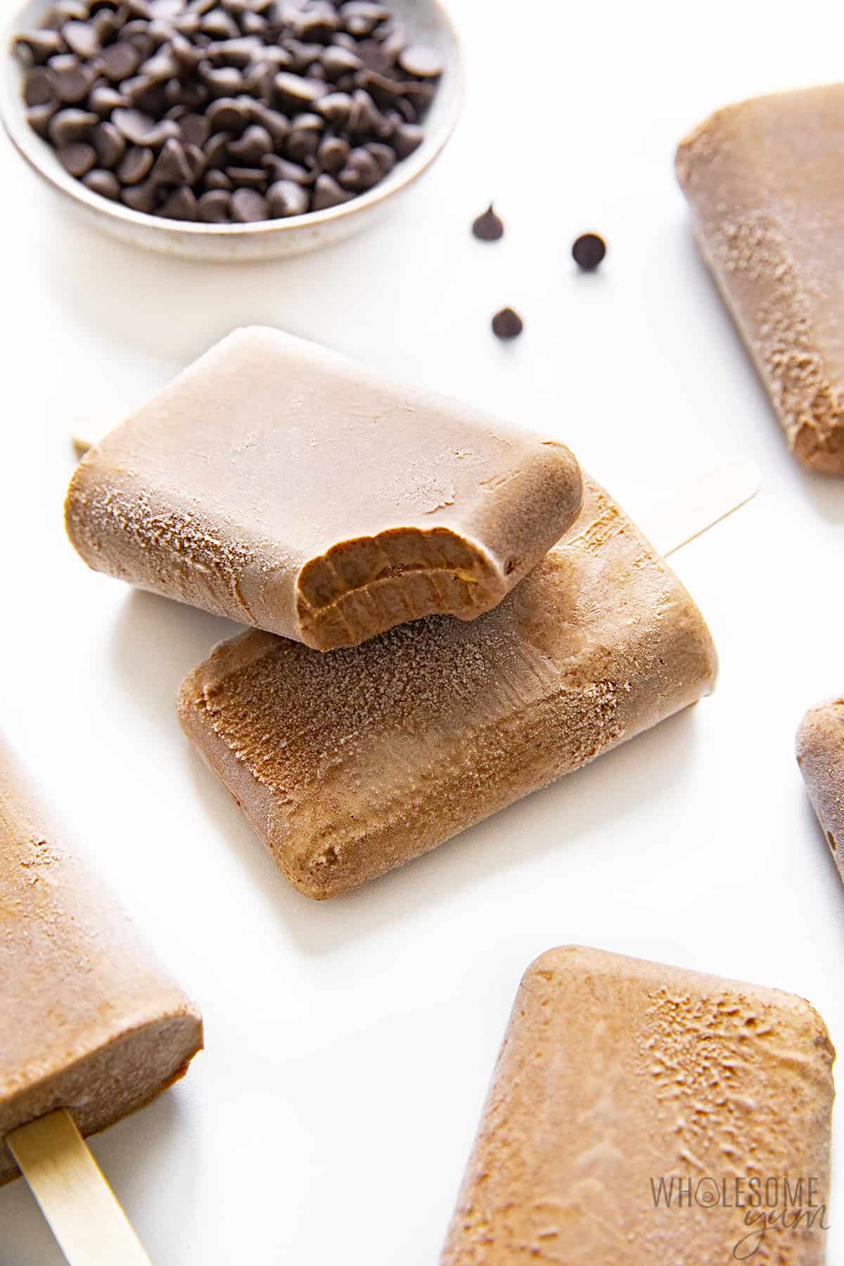 Scattered sugar free fudge pops with one bite taken out of one pop
