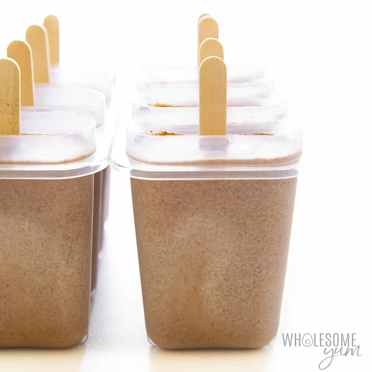 Healthy fudge pops in popsicle mold with sticks inserted