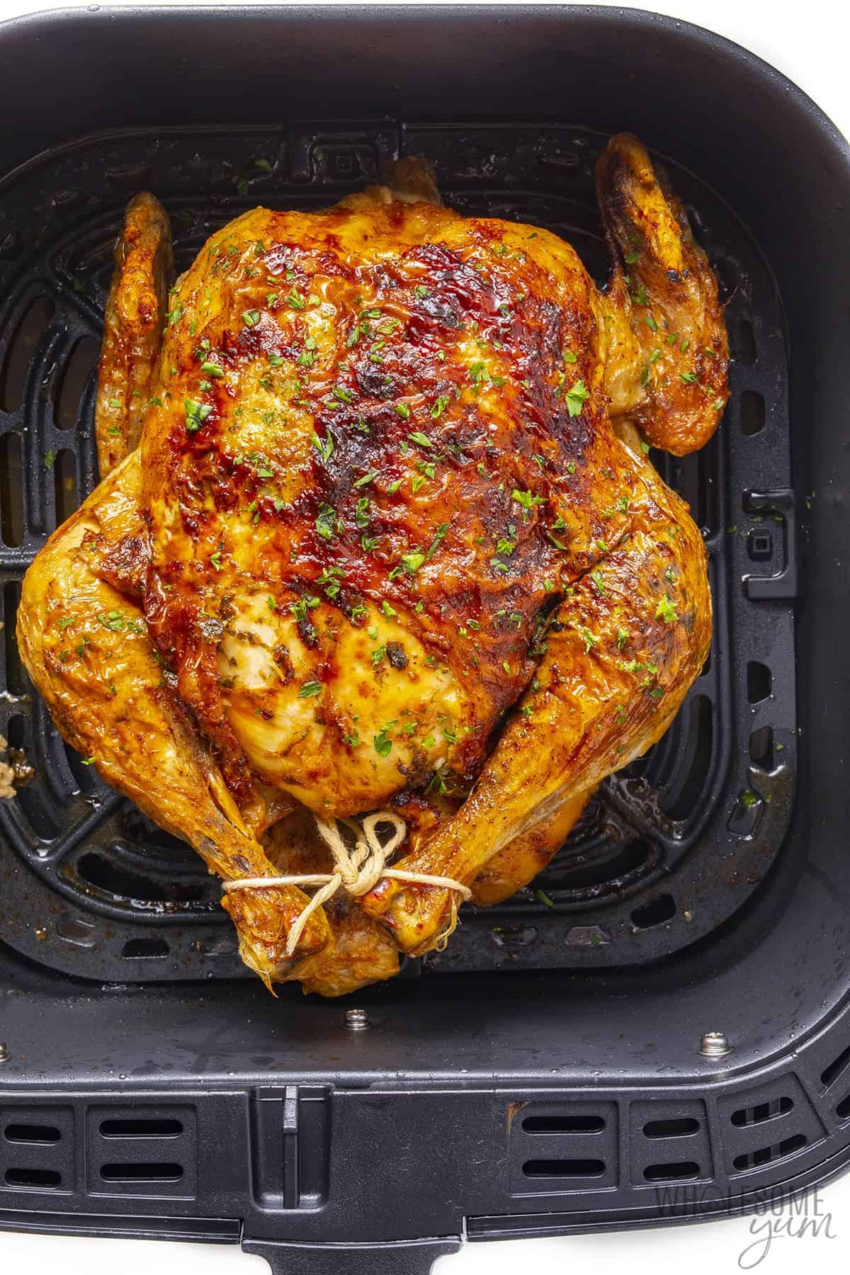 Fully cooked chicken in the air fryer basket