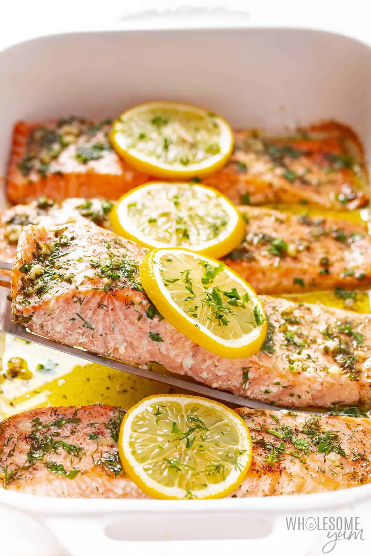 Baking dish with oven baked salmon